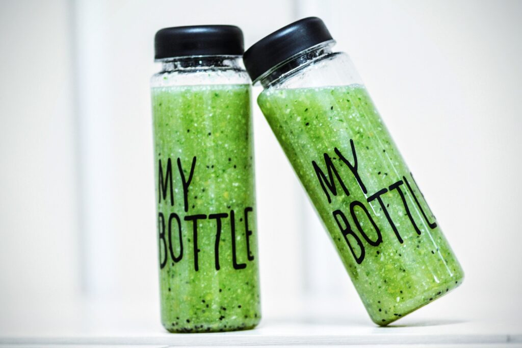 Cucumber paste in two glass bottles